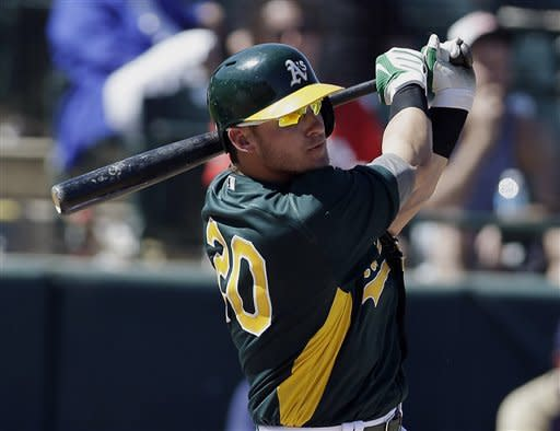 Oakland Athletics' Josh Donaldson drives in a run with a double against the Milwaukee Brewers during the third inning of an exhibition spring training baseball game on Monday, March 25, 2013 in Phoenix. (AP Photo/Marcio Jose Sanchez)