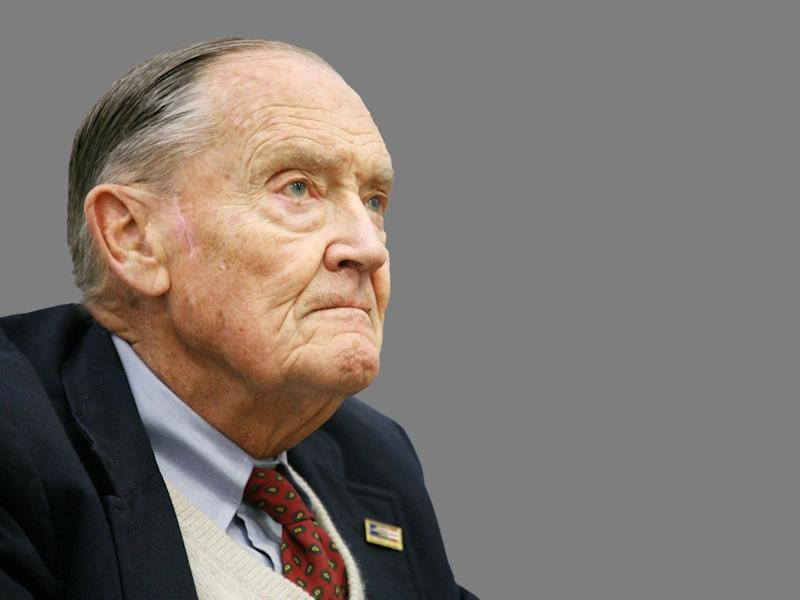 Jack Bogle headshot, founder and former CEO of The Vanguard Group, graphic element on gray