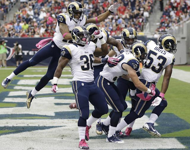 St. Louis Rams celebrate a touchdown by Daren Bates (53), right, against the Houston Texans during the third quarter of an NFL football game Sunday, Oct. 13, 2013, in Houston, Texas. (AP Photo/Eric Gay)