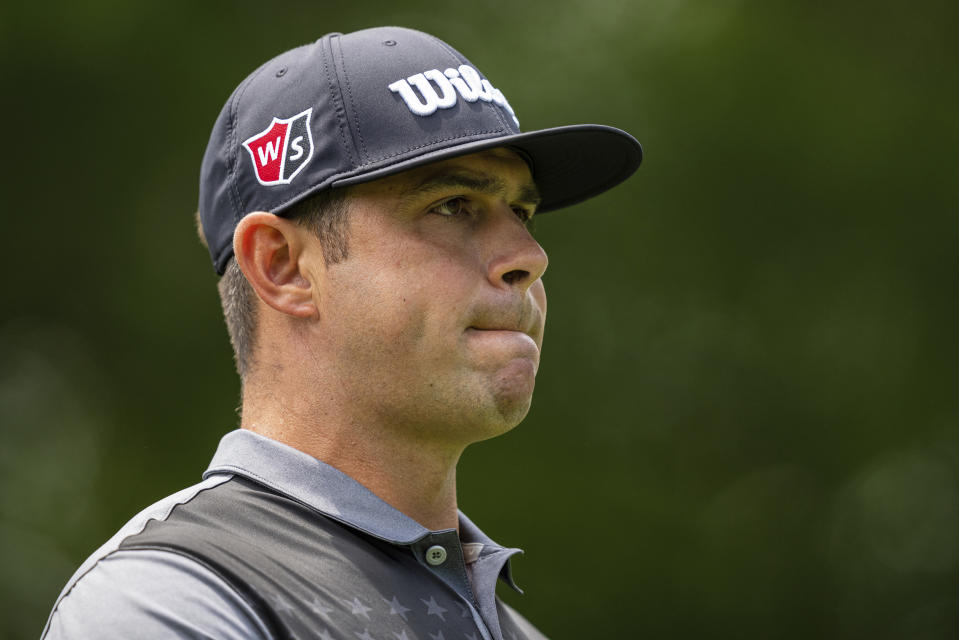 Gary Woodland looks down the fairway on the second hole during the third round of the Wells Fargo Championship golf tournament at Quail Hollow on Saturday, May 8, 2021, in Charlotte, N.C. (AP Photo/Jacob Kupferman)