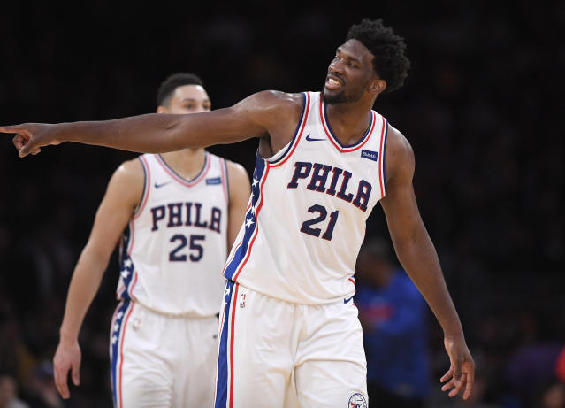 Joel Embiid gestures toward actor Kevin Hart in the front row after scoring. No, seriously. (AP Photo/Mark J. Terrill)