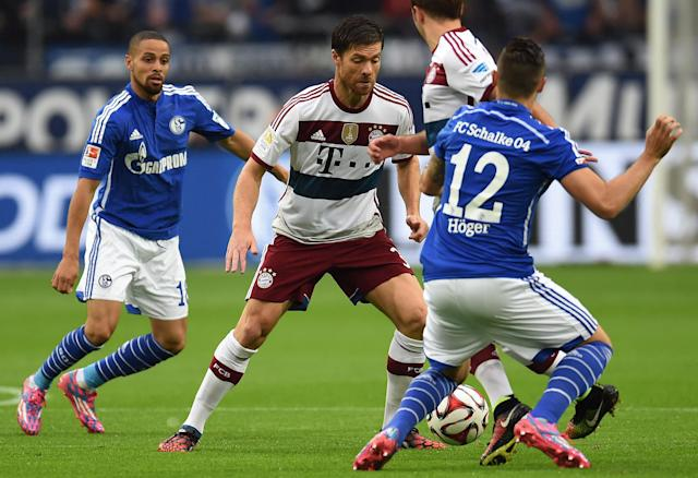 (From L) Schalke's forward Sidney Sam, Bayern Munich's Spanish midfielder Xabi Alonso, Bayern Munich's midfielder Mario Goetze and Schalke's midfielder Marco Hoeger vie for the ball in Gelsenkirchen on August 30, 2014 (AFP Photo/Patrik Stollarz)