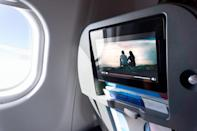 """Many modern models of planes come with built-in screens, allowing you to select <a href=""""https://bestlifeonline.com/tag/tv/?utm_source=yahoo-news&utm_medium=feed&utm_campaign=yahoo-feed"""" rel=""""nofollow noopener"""" target=""""_blank"""" data-ylk=""""slk:TV shows"""" class=""""link rapid-noclick-resp"""">TV shows</a> or <a href=""""https://bestlifeonline.com/tag/movies/?utm_source=yahoo-news&utm_medium=feed&utm_campaign=yahoo-feed"""" rel=""""nofollow noopener"""" target=""""_blank"""" data-ylk=""""slk:movies"""" class=""""link rapid-noclick-resp"""">movies</a> from a robust Netflix-like library. These entertainment options may make the flight feel less arduous, but the screens could also be exposing you to a wide range of germs. Archer says that if you opt to use this feature, make sure to wipe the screen down with a disinfectant first."""