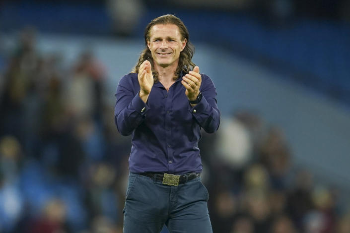 Wycombe Wanderers manager Gareth Ainswort gestures to the crowd following the English League Cup third round soccer match between Manchester City and Wycombe Wanderers at Etihad Stadium, in Manchester England, Tuesday, Sept. 21, 2021. (AP Photo/Dave Thompson)