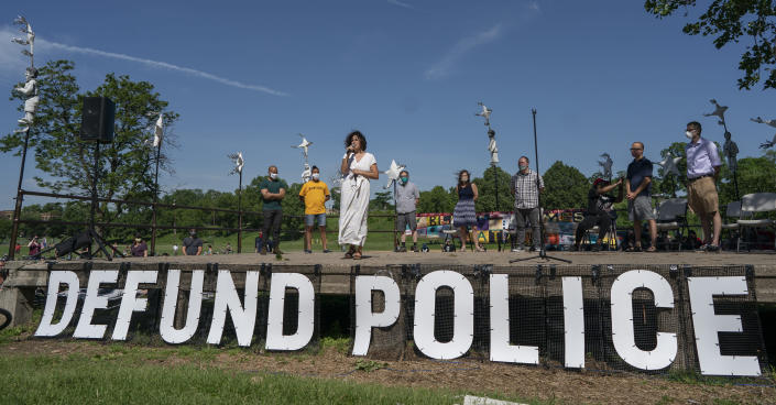 """FILE - In this Sunday, June 7, 2020, file photo, Alondra Cano, a city council member, speaks during """"The Path Forward"""" meeting at Powderhorn Park in Minneapolis, which was organized to talk about the defunding of the Minneapolis Police Department. On Tuesday, Sept. 14, 2021, a judge rejected an attempt to salvage a proposed charter amendment on the future of policing in Minneapolis, ruling just days before early and absentee voting begins in the city where George Floyd died in police custody that any votes on the question won't count. (Jerry Holt/Star Tribune via AP, File)"""