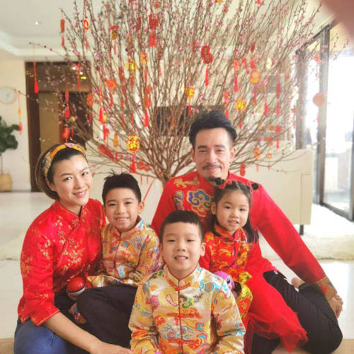 Moses with wife and kids during the Lunar New Year