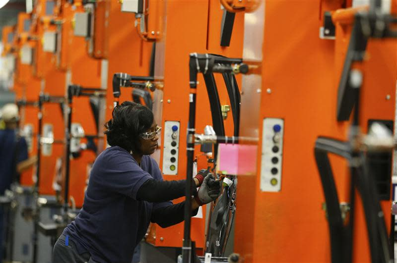 A BMW employee works on the door assembly for the X4 at the BMW manufacturing plant in Spartanburg