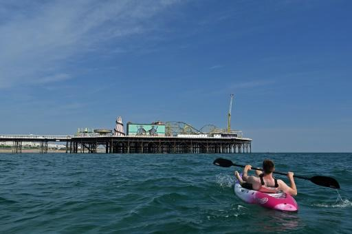 Simple pleasures such as a paddle can keep some locals happy -- but British tourism authorities are fretting the economy stands to lose billions in lost revenue from overseas visitors