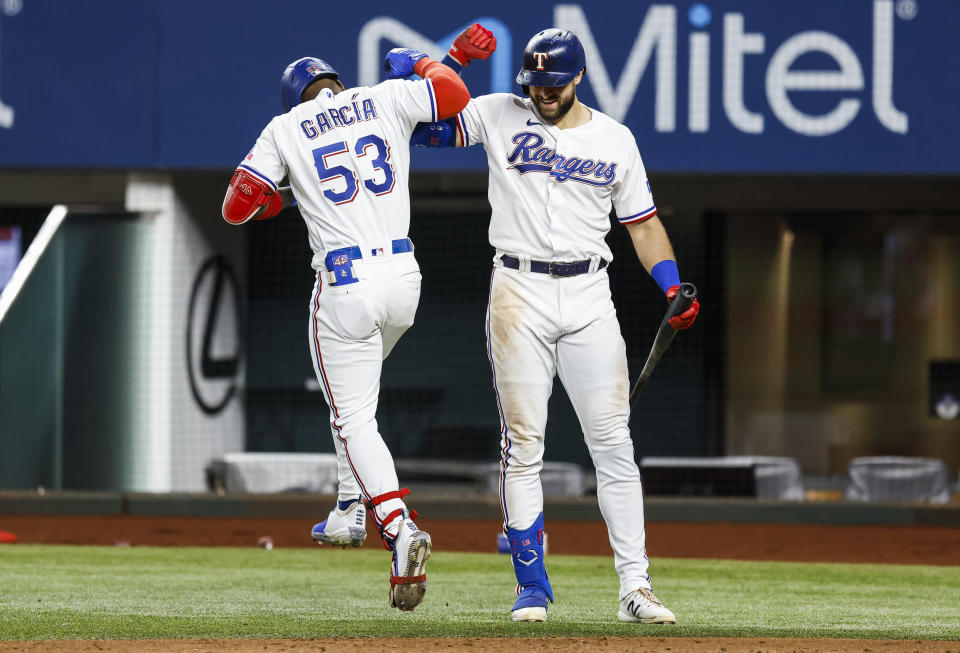 Texas Rangers' Adolis Garcia (53) is congratulated by Joey Gallo after hitting a solo home run during the sixth inning of a baseball game against the Oakland Athletics, Wednesday, June 23, 2021, in Arlington, Texas. (AP Photo/Brandon Wade)