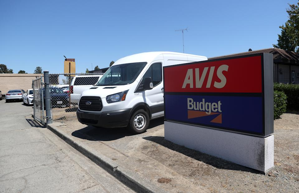SAN RAFAEL, CALIFORNIA - JULY 28: A sign is posted in front of an Avis Budget rental car office on July 28, 2020 in San Rafael, California. Avis Budget Group reported second quarter earnings with an adjusted net loss of $388 million and a 67 percent decline in revenues compared to one year ago. (Photo by Justin Sullivan/Getty Images)