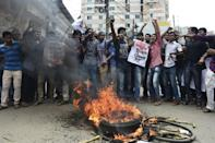 Students block the road during a protest in the Bangladeshi capital Dhaka on April 7, 2016 following the latest in a string of activist killings