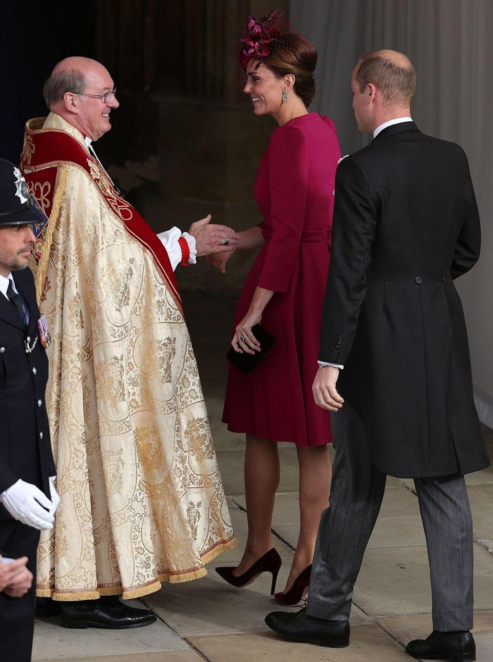 """<p>Kate Middleton wore <a href=""""https://www.townandcountrymag.com/society/tradition/a23455715/kate-middleton-princess-eugenie-royal-wedding-outfit/"""" rel=""""nofollow noopener"""" target=""""_blank"""" data-ylk=""""slk:a stunning pink dress"""" class=""""link rapid-noclick-resp"""">a stunning pink dress</a> by Alexander McQueen while attending Princess Eugenie and Jack Brooksbank's wedding. She accessorized the look with a hat by Philip Treacy. </p>"""