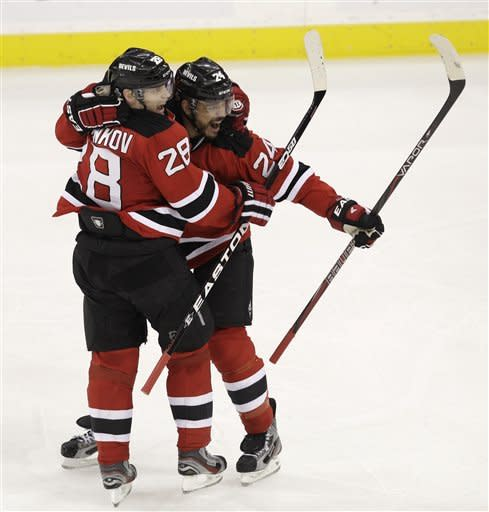 New Jersey Devils' Bryce Salvador celebrates a goal with Anton Volchenkov, of Russia, in the second period during Game 5 of the NHL hockey Stanley Cup finals against the Los Angeles Kings Saturday, June 9, 2012, in Newark, N.J.. (AP Photo/Kathy Willens)