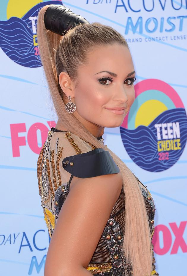 "When she hosted the Teen Choice Awards in July, Lovato made several hair and outfit changes. And although it looked like she had decided to finally ditch the blue, it was just a hair trick of the trade. ""It looks like I had gotten rid of the blue hair, but it was all hidden in that black thing,"" she says. ""What you see is all one long blond extension; the blue hair [is tucked away]. So crazy right?"""