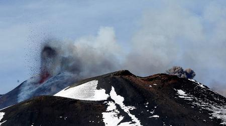 FILE PHOTO Italy's Mount Etna, Europe's tallest and most active volcano, spews lava as it erupts on the southern island of Sicily, Italy February 28, 2017. REUTERS/Antonio Parrinello/File photo