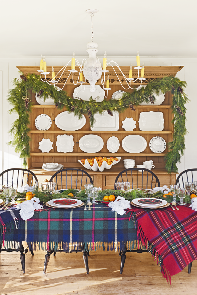 """<p>Make over the tabletops in your home with inexpensive tartan blankets, scarves, tablecloths, and more. It's the easiest and fastest way for adding some festive flair to any room, according to <a href=""""https://www.countryliving.com/home-design/house-tours/g4928/christmas-in-connecticut/"""" rel=""""nofollow noopener"""" target=""""_blank"""" data-ylk=""""slk:blogger Nora Murphy"""" class=""""link rapid-noclick-resp"""">blogger Nora Murphy</a>, who uses thrifted wool blankets in her home.</p><p><a href=""""https://www.wayfair.com/bed-bath/sb1/plaid-blankets-throws-c415002-a18804~75894.html"""" rel=""""nofollow noopener"""" target=""""_blank"""" data-ylk=""""slk:SHOP PLAID THROWS"""" class=""""link rapid-noclick-resp"""">SHOP PLAID THROWS</a></p>"""