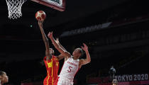 Spain's Astou Ndour (45) shoots over Canada's Kia Nurse (5) during women's basketball preliminary round game at the 2020 Summer Olympics, Sunday, Aug. 1, 2021, in Saitama, Japan. (AP Photo/Charlie Neibergall)