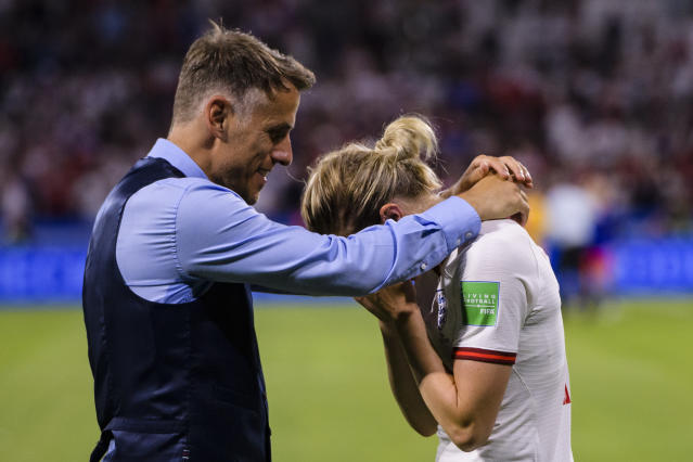 Ellen White of England (R) and Head Coach Philip Neville of England (L) cries after been defeated by USA during the 2019 FIFA Women's World Cup France Semi Final match between England and USA at Stade de Lyon on July 2, 2019 in Lyon, France. (Photo by Marcio Machado/Getty Images)