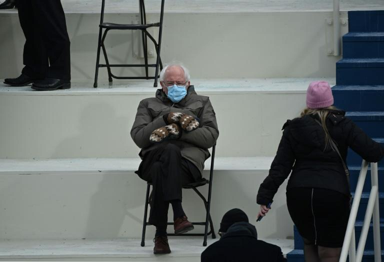 Former presidential candidate Senator Bernie Sanders (D-Vermont) sits in the bleachers at the Capitol before Joe Biden is sworn in as the 46th US President on January 20, 2021