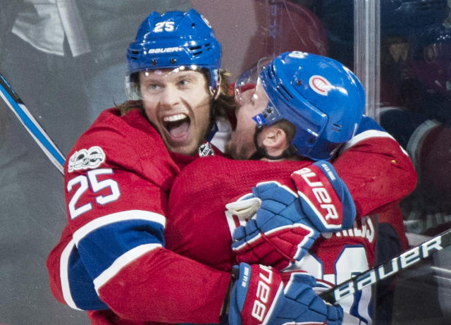 FILE - In this Saturday, Dec. 2, 2017, file photo, Montreal Canadiens' Jacob de la Rose (25) celebrates with teammate Nicolas Deslauriers after scoring against the Detroit Red Wings during the second period of an NHL hockey game, in Montreal. On Wednesday, Oct. 17, 2018, the winless Detroit Red Wings claimed winger Jacob de la Rose off waivers from Montreal. (Graham Hughes/The Canadian Press via AP, File)