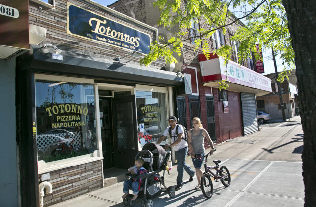 This June 12, 2012 photo shows Totonno's Pizzeria in the Coney Island section in the Brooklyn borough of New York. The eatery has reopened after being closed 5 months from superstorm Sandy damage. (AP Photo/Bebeto Matthews)