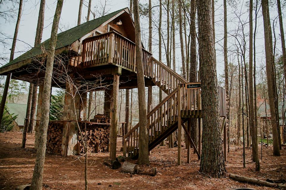 """<h2>Luxury Stone and Timber Tree House On 20-Acre Farm</h2><br>If sleeping in the woods is more your speed than the desert, this treehouse is the perfect option for <a href=""""https://www.refinery29.com/en-us/romantic-weekend-getaways-for-couples"""" rel=""""nofollow noopener"""" target=""""_blank"""" data-ylk=""""slk:your couple's retreat"""" class=""""link rapid-noclick-resp"""">your couple's retreat</a>. With a pool, hot tub, hammock, and fire pit, you'll never feel bored during your weekend in the woods.<br><br><strong>Location: </strong>Concord, NC<br><strong>Sleeps: </strong>2<br><strong>Price Per Night: </strong>$150<br><br><strong><a href=""""https://www.airbnb.com/rooms/19729534"""" rel=""""nofollow noopener"""" target=""""_blank"""" data-ylk=""""slk:Book here"""" class=""""link rapid-noclick-resp"""">Book here</a></strong><span class=""""copyright"""">Photo: Courtesy of Airbnb.</span>"""