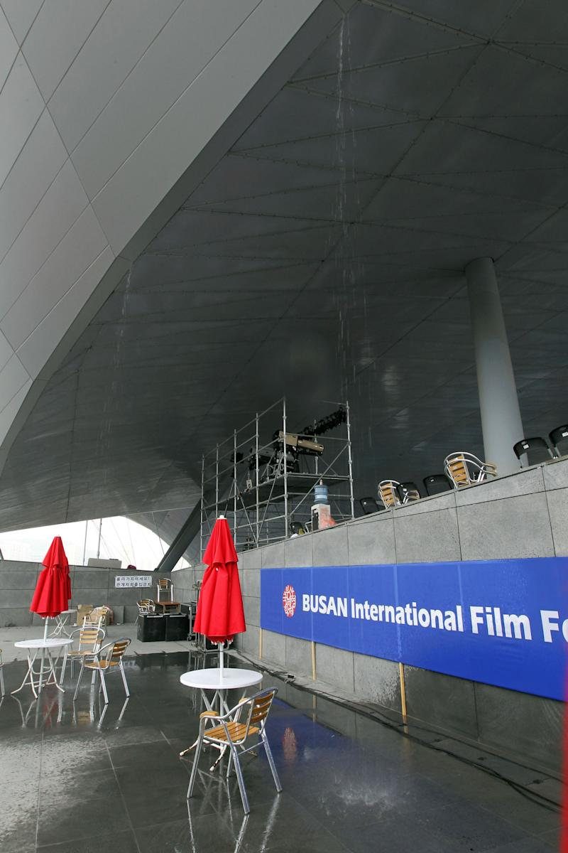 Rainwater drops on the floor from the ceiling of the Busan Cinema Center in Busan, South Korea, Friday, Oct. 14, 2011. Organizers of the Busan International Film Festival, Asia's top film festival, vowed that its closing ceremony would still go ahead Friday despite rainwater leaking into the lavish new multiplex that has been the showpiece for this year's event. (AP Photo/Yonhap, Jo Jung-ho)  KOREA OUT