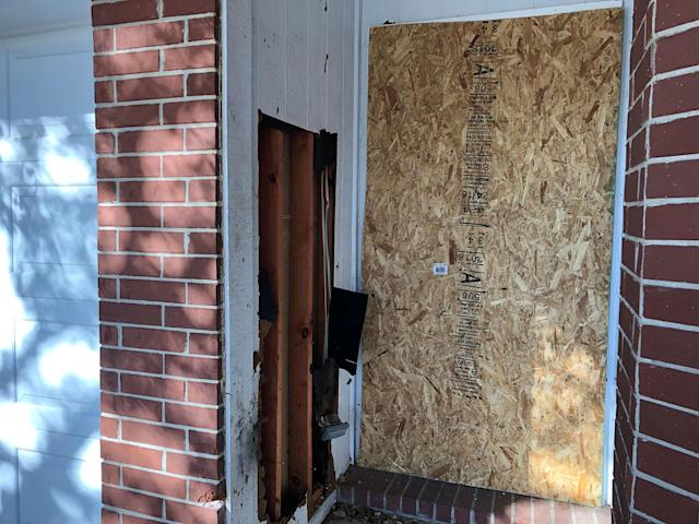 <p>The doorway of a home that was hit with a fatal parcel bomb on March 2, 2018 is seen boarded-up in Austin, Texas, March 12, 2018. (Photo: Jon Herskovitz/Reuters) </p>