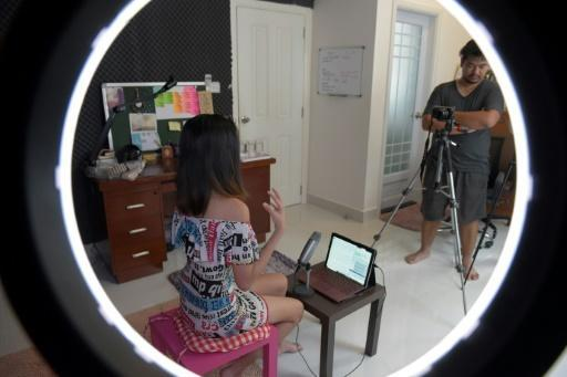 Cambodia's Catherine Harry records a video for her blog, which delves into issues such as sex toys, infidelity and penis size