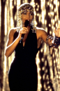<p>Leave it to Whitney Houston to make a lasting impression just from wearing a simple black halter gown. Sure, the beaded accessories add to the effect, as well as the singer's mighty vocals, but the dress is the perfect juxtaposition to the high glam on display.</p>