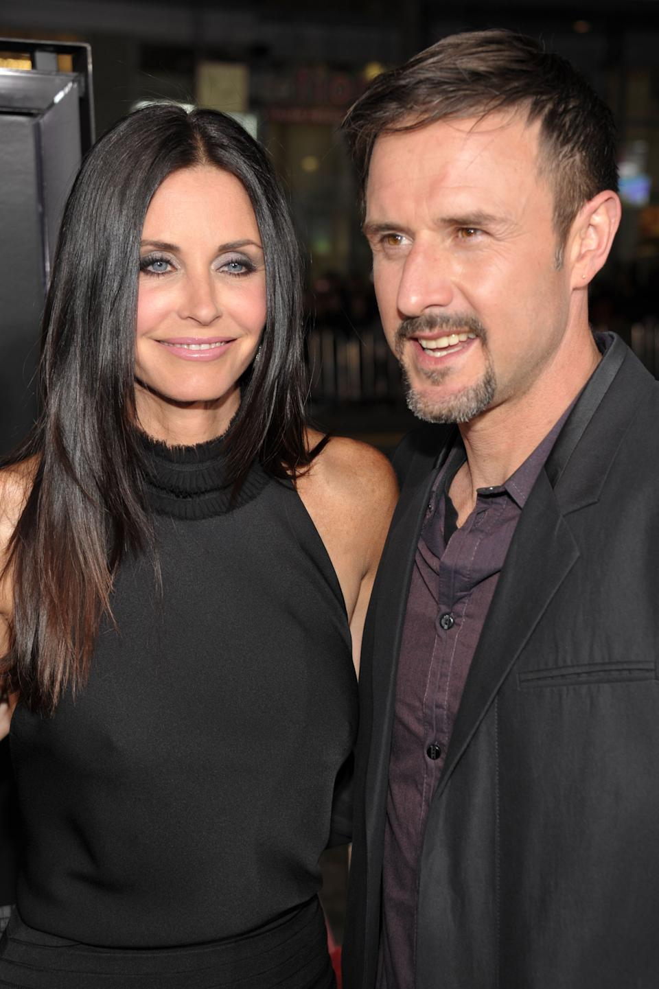 """Actors Courteney Cox and David Arquette arrive at the world premiere of The Weinstein Company's """"Scream 4"""" presented by AXE Shower at Grauman's Chinese Theatre on April 11, 2011 in Hollywood, California."""