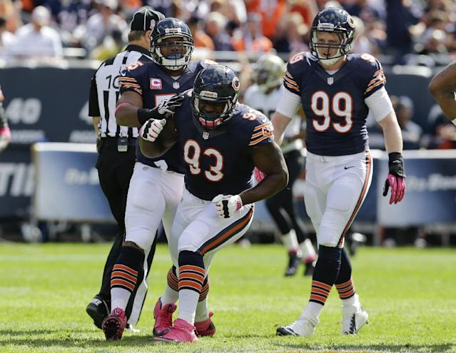 Chicago Bears defensive tackle Nate Collins (93) celebrates with outside linebacker Lance Briggs (55) and defensive end Shea McClellin (99) after sacking New Orleans Saints quarterback Drew Brees during the first half of an NFL football game, Sunday, Oct. 6, 2013, in Chicago.(AP Photo/Nam Y. Huh)