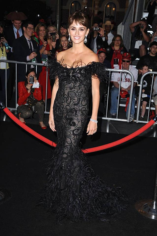 """Back in Los Angeles, Oscar winner Penelope Cruz delivered some drama upon arriving at the world premiere of """"Pirates of the Caribbean: On Stranger Tides"""" in a """"Black Swan""""-inspired Marchesa masterpiece and Chopard jewels. Steve Granitz/<a href=""""http://www.wireimage.com"""" target=""""new"""">WireImage.com</a> - May 7, 2011"""