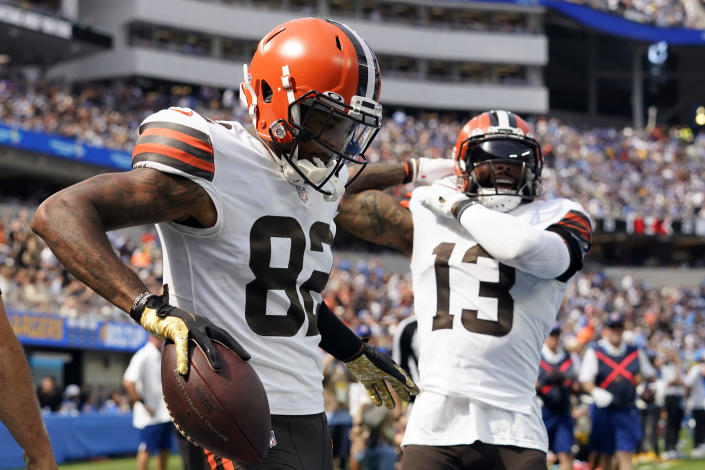 Cleveland Browns wide receiver Rashard Higgins (82) celebrates his touchdown catch with wide receiver Odell Beckham Jr. (13) during the first half of an NFL football game against the Los Angeles Chargers Sunday, Oct. 10, 2021, in Inglewood, Calif. (AP Photo/Gregory Bull)