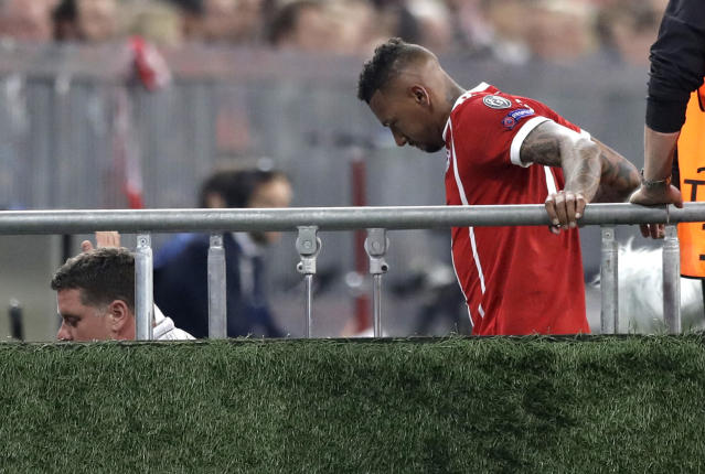 Bayern's Jerome Boateng leaves the pitch after suffering an injury during the semifinal first leg soccer match between FC Bayern Munich and Real Madrid at the Allianz Arena stadium in Munich, Germany, Wednesday, April 25, 2018. (AP Photo/Matthias Schrader)