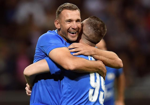 Former AC Milan player Andriy Shevchenko celebrates with Antonio Cassano during Andrea Pirlo's farewell soccer match at the San Siro stadium in Milan, Italy, May 21, 2018. REUTERS/Daniele Mascolo
