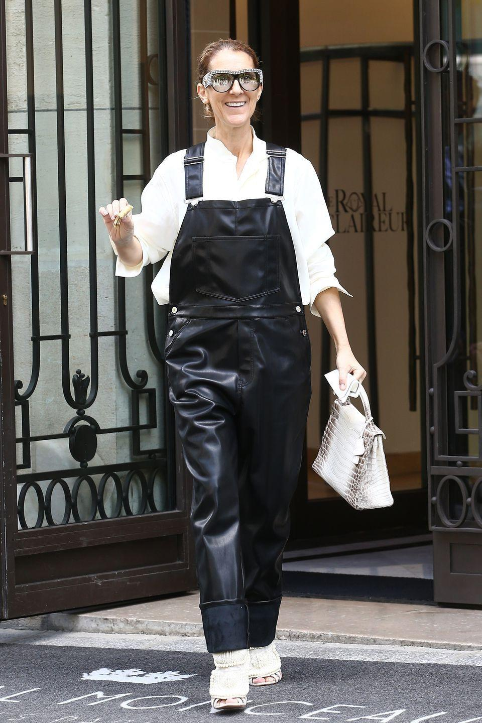 <p>In Givenchy faux leather overalls, a white button-down shirt, Kanye West x Giuseppe Zanotti sandals, and jewel-embellished sunglasses in Paris. </p>