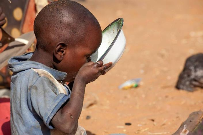 A child drinks water at Zam Zam camp for Internally Displaced People near El Fasher in Darfur, Sudan, on February 18, 2015, in this photo released by the United Nations-African Union Mission in Darfur (UNAMID) (AFP Photo/Hamid Abdulsalam)