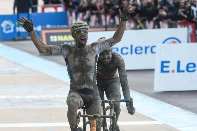 Bahrain Victorious Sonny Colbrelli from Italy (L) celebretes as he crosses the finish line, past Lotto Soudal Florian Vermeersch from Belgium (R), to win the 118th edition of the Paris-Roubaix one-day classic cycling race, between Compiegne and Roubaix, in the Velodrome stadium in Roubaix, northern France, on October 3, 2021. (Photo by FRANCOIS LO PRESTI / AFP) (Photo by FRANCOIS LO PRESTI/AFP via Getty Images) (Photo: FRANCOIS LO PRESTI via Getty Images)
