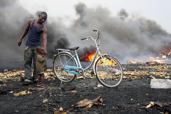 People burn wires and other electronics to obtain valuable cooper and other materials, but this process also releases toxic fumes at the Agbogbloshie dumpsite in Accra, Ghana.
