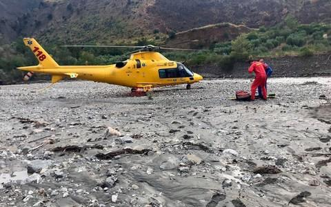 <span>A rescue helicopter in the gorge that was hit by a flash flood</span> <span>Credit: Francesco Arena/Ansa </span>