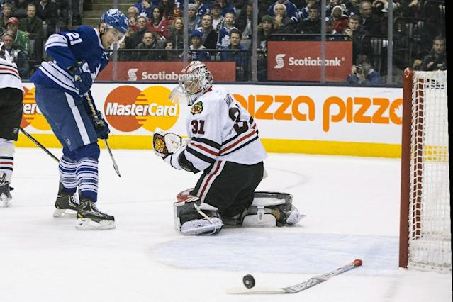 Chicago Blackhawks' goaltender Antti Raanta, right, looks back as Toronto Maple Leafs James van Riemsdyk's shot drifts wide of the net during the second period of an NHL hockey game in Toronto on Saturday, Dec. 14, 2013. (AP Photo/The Canadian Press, Chris Young)