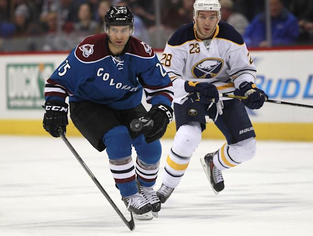 Colorado Avalanche center Maxime Talbot, left, pursues the puck with Buffalo Sabres center Zemgus Girgensons, right, in the first period of an NHL hockey game in Denver, Saturday, Feb. 1, 2014. (AP Photo/David Zalubowski)