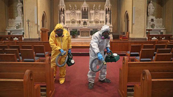 PHOTO: Mark Burgess, left, and David Rossini with Bostonian Cleaning and Restoration of Braintree cleans the aisle at St. Gregory's Church in Boston's Dorchester during the COVID-19 pandemic on May 18, 2020. (David L. Ryan/The Boston Globe via Getty Images)