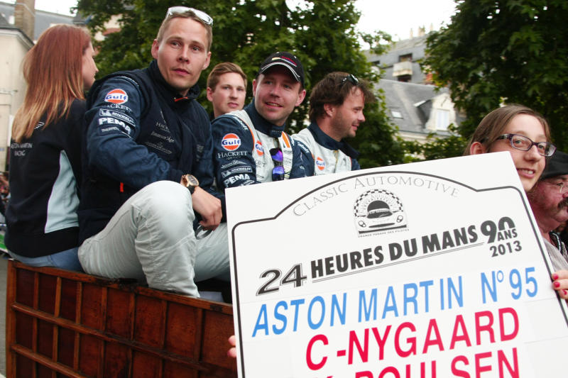"FILE - Danish Driver Allan Simonsen, left, is seen during a parade on the eve of the 90th 24-hour Le Mans endurance race, in Le Mans, western France, in this Friday, June 21, 2013 photo. The No.95 Aston Martin Vantage GTE, driven by Simonsen, exited the track at high speed at the ""Tertre Rouge"" corner on his fourth lap of the race, He died after due to his injuries, Saturday, June 22, 2013.(AP Photo/Michel Spingler, File)"