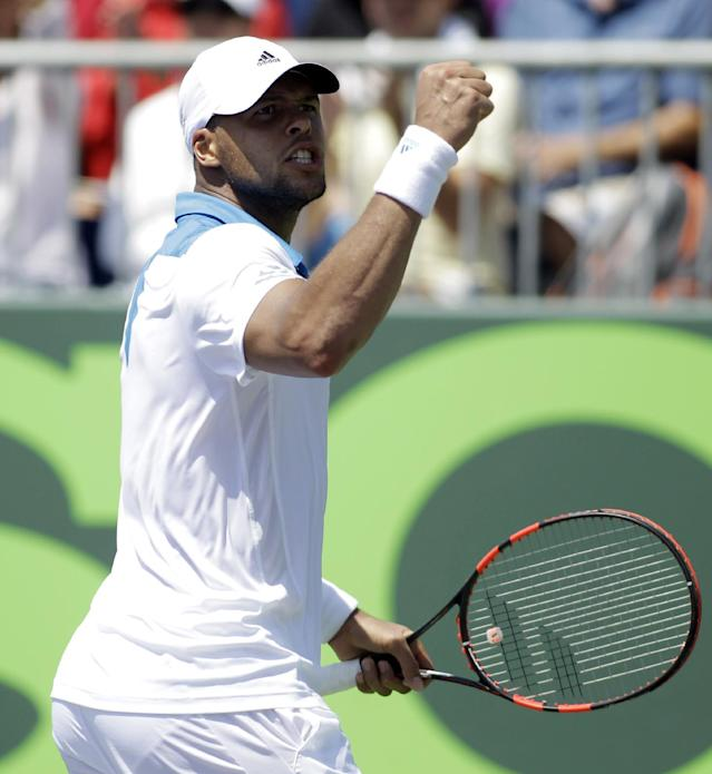 Jo-Wilfried Tsonga, of France, reacts after a play against Marcos Baghdatis, of Cyprus, during the Sony Open tennis tournament, Sunday, March 23, 2014, in Key Biscayne, Fla. Tsonga won 4-6, 7-6(6), 7-5. (AP Photo/Luis M. Alvarez)