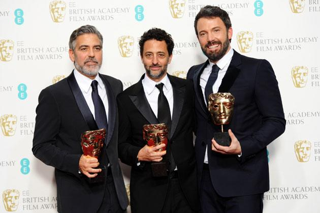 Best Film winners George Clooney, Grant Heslov and Ben Affleck pose in the press room at The EE British Academy Film Awards 2013 at The Royal Opera House on February 10, 2013 in London, England. (Photo by Dave J Hogan/Getty Images)