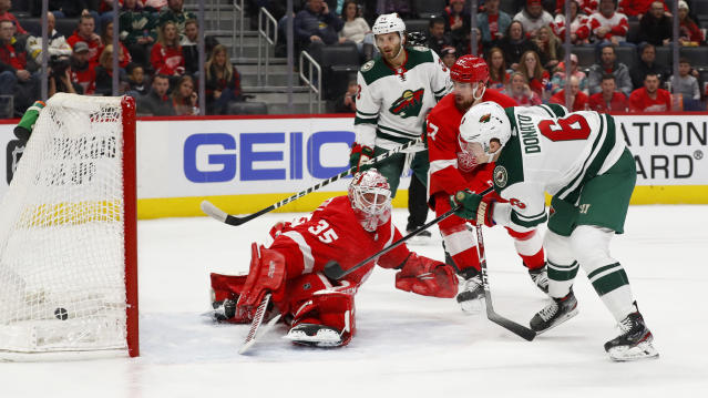 Minnesota Wild center Ryan Donato (6) scores on Detroit Red Wings goaltender Jimmy Howard (35) in the first period of an NHL hockey game Thursday, Feb. 27, 2020, in Detroit. (AP Photo/Paul Sancya)