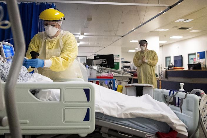 A nurse works on a patient in the ICU (Intensive Care Unit) in St George's Hospital in Tooting, south-west London, where the number of intensive care beds for the critically sick has had to be increased from 60 to 120, the vast majority of which are for coronavirus patients.