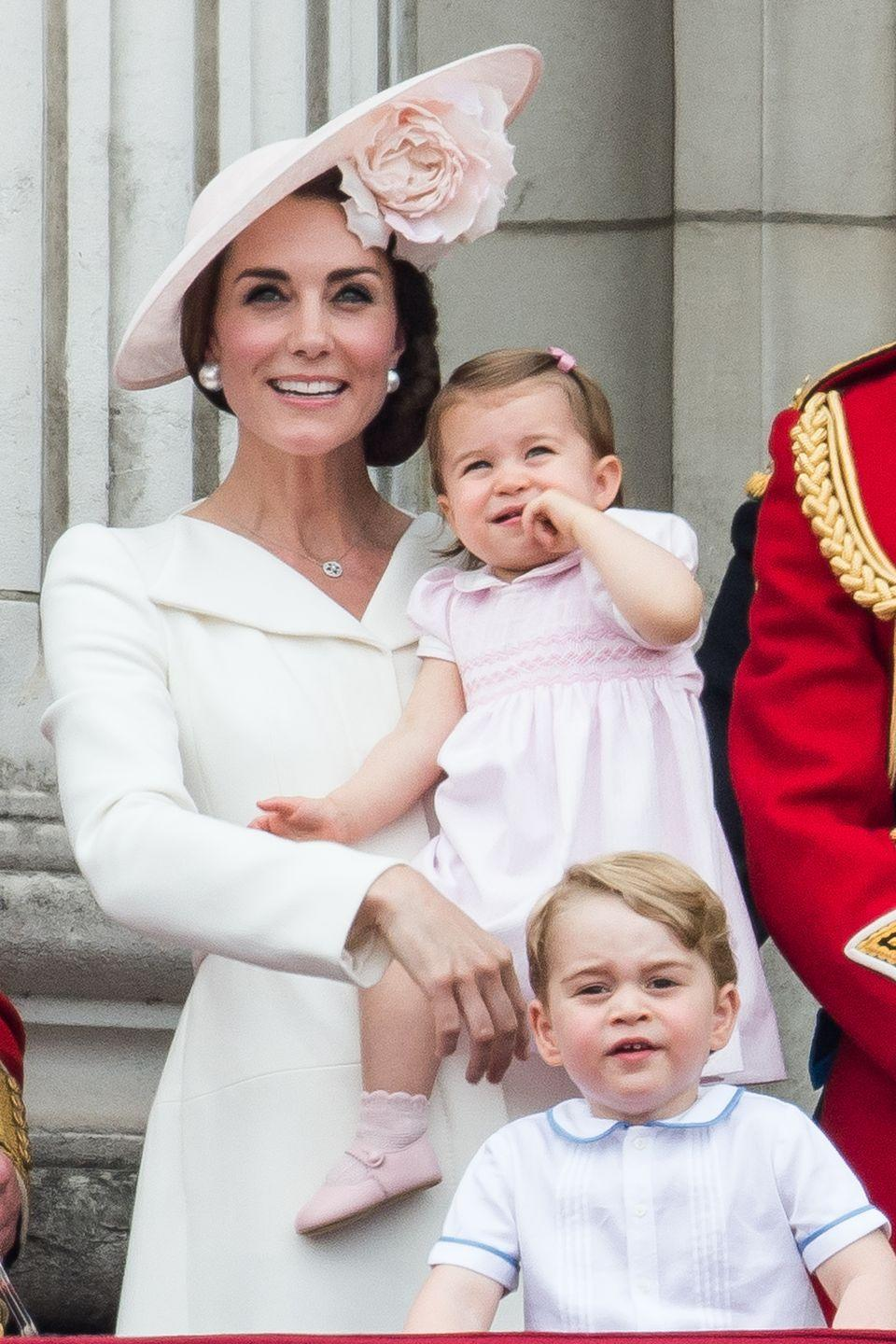 <p>The Duchess of Cambridge stands with Princess Charlotte and Prince George on the balcony at Buckingham Palace during the Trooping the Colour marking the Queen's official 90th birthday.</p>